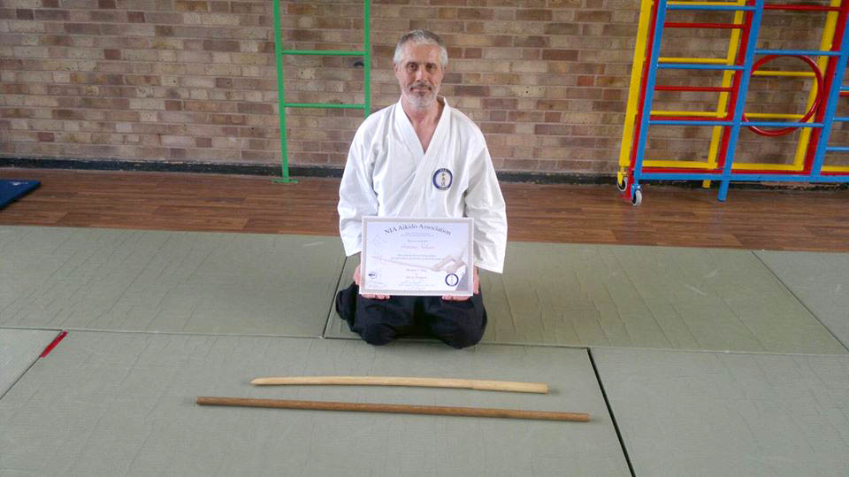 Sensei Nelson receiving his shodan in weapons