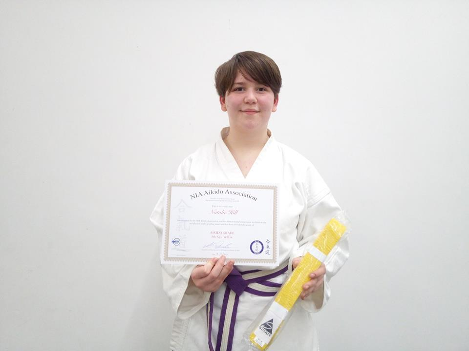 Natalie receiving her yellow belt
